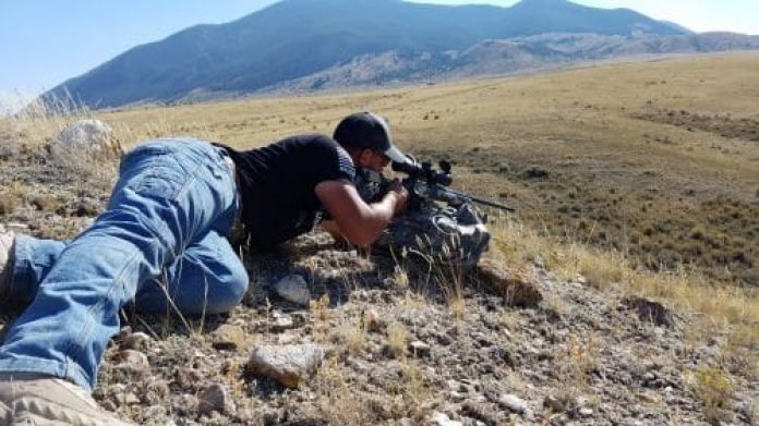 Jordan Harmon steadies his rifle